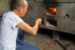 Wu Fengxiang roasting peppers by Marie Anna Lee