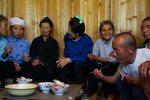 Talking and drinking rice wine at lunch gathering by Marie Anna Lee