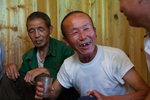 Drinking rice wine at lunch gathering by Marie Anna Lee