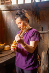 Wu Liangming lighting kindling in kitchen by Marie Anna Lee