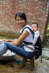 Baby in traditional carrier by Marie Anna Lee