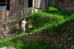 Woman carrying baskets of water fern Azolla by Anastasya Uskov