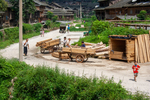 Lumber on carts by Anastasya Uskov