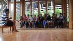Wu Zhangshi leading children choir practice