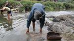 Washing boiled bark in river