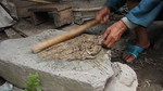 Mashing boiled bark into paper pulp