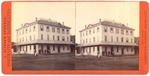 Stockton: (Large three story building with men in front.)
