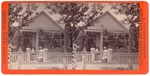 Stockton: (House with two adults, one baby on porch, two people by gate.)