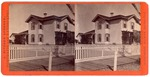 Stockton: (Large house with picket fence.)