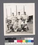 Baseball: team posing in uniform by Richard Shizuo Yoshikawa