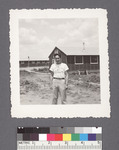 One man #34 [building in backkground] by Richard Shizuo Yoshikawa