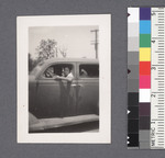One man #37 [sitting in car] by Richard Shizuo Yoshikawa