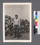 One man #38 [in front of woodpile] by Richard Shizuo Yoshikawa