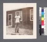 One man #42 [standing in front of building] by Richard Shizuo Yoshikawa