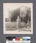 One woman #10 [in front of building] by Richard Shizuo Yoshikawa