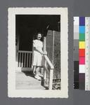 One woman #104 [standing on porch] by Richard Shizuo Yoshikawa