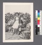 One woman #12 [in front of woodpile] by Richard Shizuo Yoshikawa