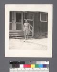One woman #18 [in front of building] by Richard Shizuo Yoshikawa