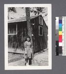 One woman #20 [in front of tree & building] by Richard Shizuo Yoshikawa